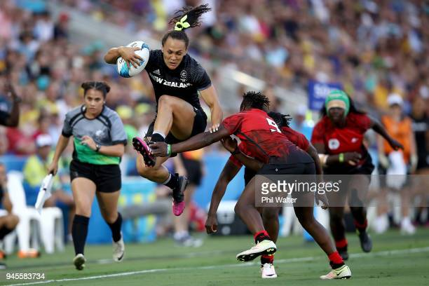 Portia Woodman of New Zealand jumps through a tackle in the match between New Zealand and Kenya during Rugby Sevens on day nine of the Gold Coast...