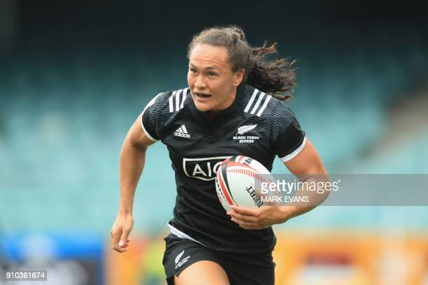 Portia Woodman of New Zealand runs with the ball against England during the Sydney World Rugby Sevens Series tournament in Sydney on January 26 2018...