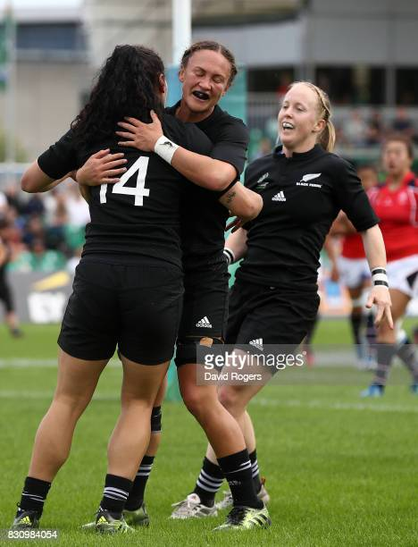 Portia Woodman of New Zeland celebrates with team mates after scoring a try during the Women's Rugby World Cup 2017 match between New Zealand and...
