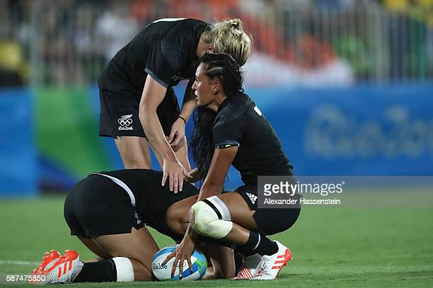 Portia Woodman of New Zeland reacts with her team mates Huriana Manuel and Ruby Tui after the Women's Gold Medal Rugby Sevens match between Australia...