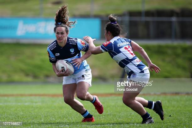 Portia Woodman of Northland looks to get past Theresa Fitzpatrick of Auckland during the round 2 Farah Palmer Cup match between Northland and...