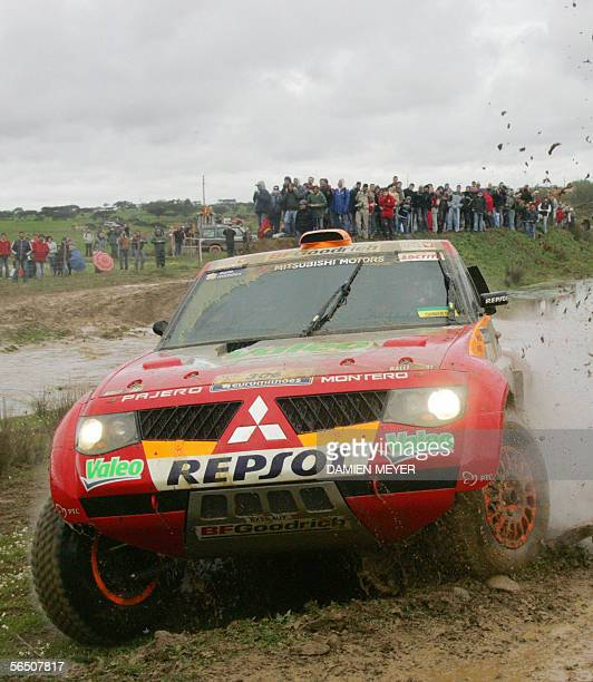 Japan's Hiroshi Masuoka steers his car 31 December 2005 between Lisbon and Portimao during the first stage of the 28th Dakar rally Spain's Carlos...