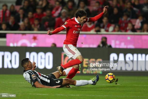 Portimonense defender Jadson from Brazil vies with Benfica's midfielder Filip Krovinovic from Croatia for the ball possession during the match...