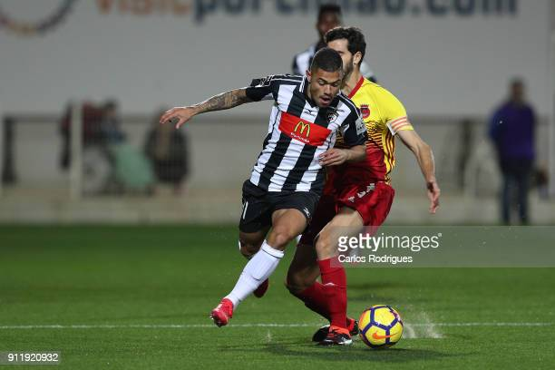 Portimonense forward Bruno Tabata from Brazil vies with Rio Ave FC midfielder Tarantini from Portugal for the ball possession during the match...