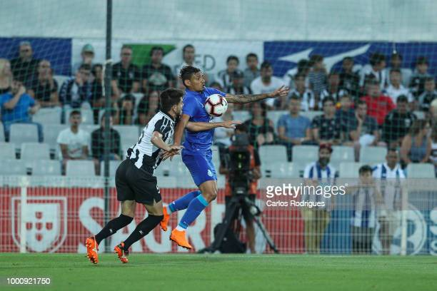 Portimonense SC defender Marcel from Brazil vies with FC Porto forward Tiquinho Soares from Brazil for the ball possession during the Portimonense SC...