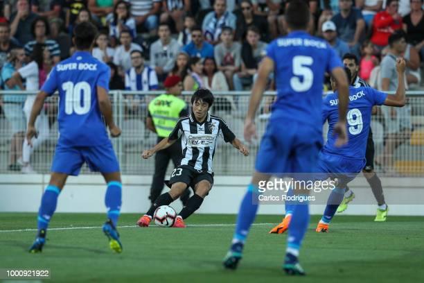 Portimonense SC forward Shoya Nakajima from Japan tries to escape Porto defenders during the Portimonense SC v FC Porto PreSeason Friendly match at...