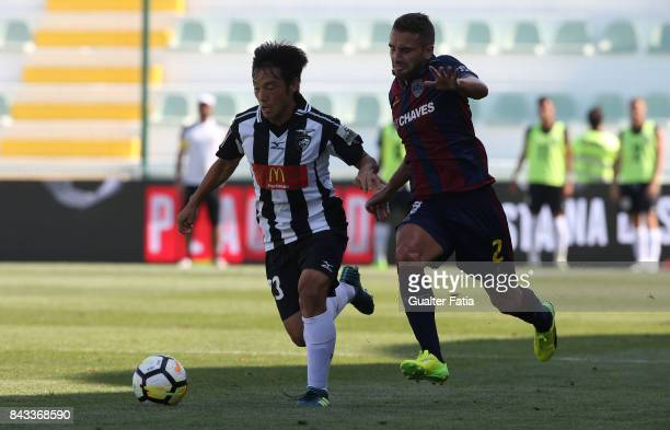 Portimonense SC forward Shoya Nakajima from Japan with GD Chaves defender Paulinho from Portugal in action during the Portuguese League Cup match...