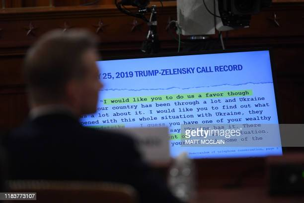 A portion of a phone transcript is seen as Fiona Hill the former top Russia expert on the National Security Council and David Holmes a State...