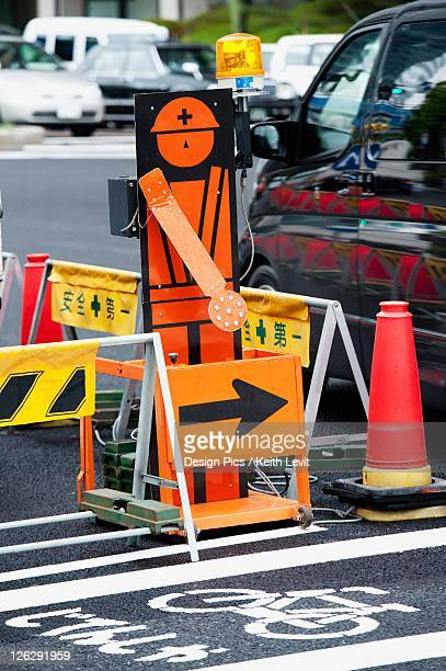 portion of a street blocked off by caution markers and pylons