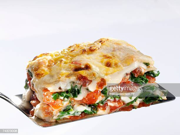 A portion of spinach lasagne on a spatula