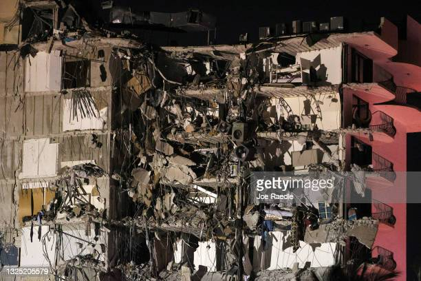 Portion of the 12-story condo tower crumbled to the ground during a partial collapse of the building on June 24, 2021 in Surfside, Florida. It is...