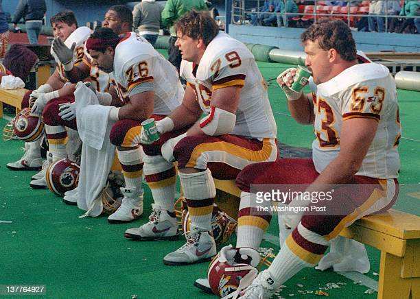 A portion of the Redskins offensive line sits on the bench for rest L to R Mark Schlereth tight End Ron Middleton Ed Simmons Jim Lachey and Jeff...