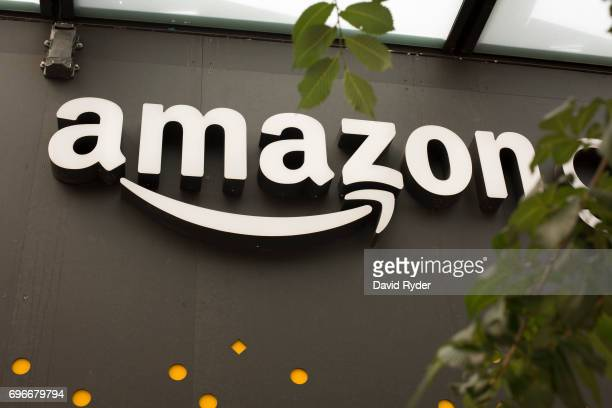 A portion of the sign advertising Amazon Go is seen outside the grocery store's location on June 16 2017 in Seattle Washington Amazon announced that...