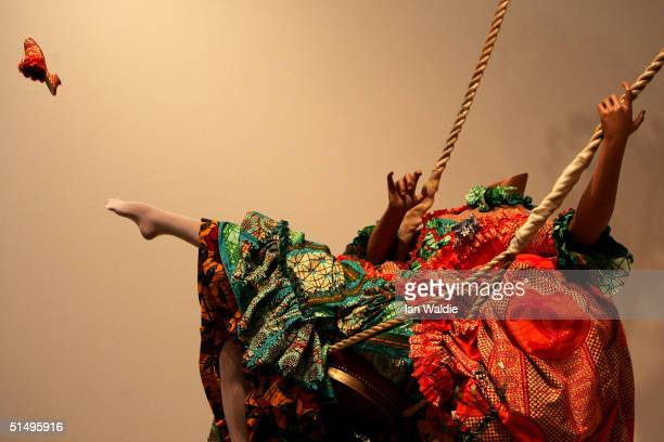 A portion of The Swing 2001 by Yinka Shonibare is seen during a preview of the Turner Prize exhibition at the Tate gallery October 19 2004 in London...