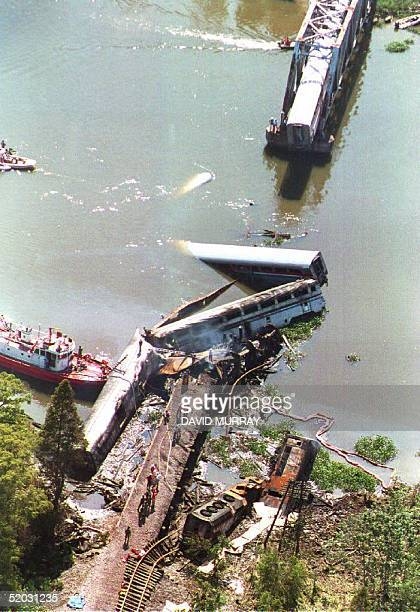 A portion the Sunset Limited an Amtrak express train running from Los Angeles to Miami lies partially submerged in a bayou about eight miles north of...