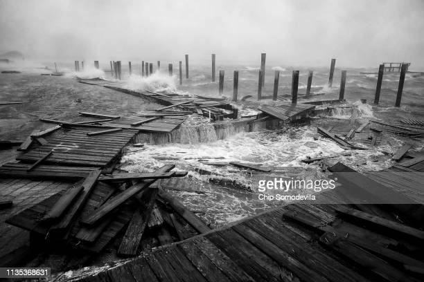 Portions of a boat dock and boardwalk are destroyed by powerful wind and waves as Hurricane Florence arrives September 13 2018 in Atlantic Beach...