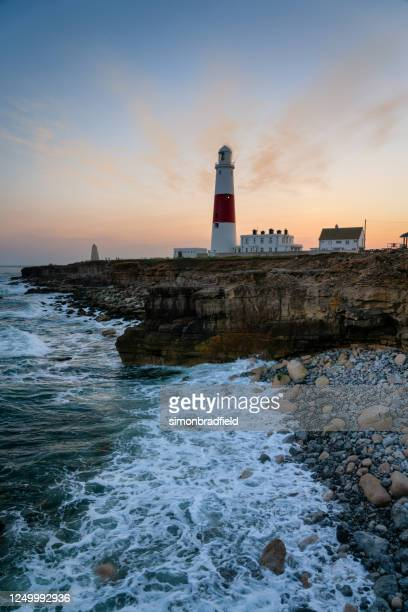 portland bill lighthouse at dusk, dorset - weymouth dorset stock pictures, royalty-free photos & images