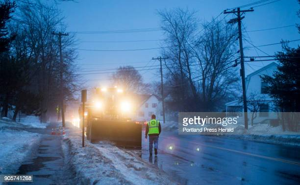 Portland city workers clear snow off of the side of Presumpscot Street Friday evening Crews work to get snow moved to lots as warmer temperatures...