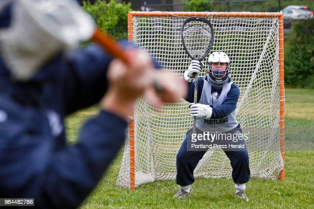 Portland goalie Aaron Hoekstra warms up with coach Mike DiFusco during a rainy practice Monday Portland has had a turnaround season The team is now...