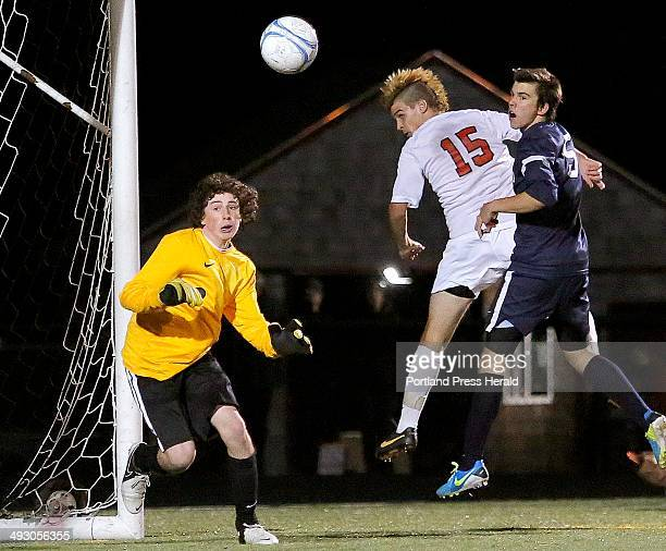 Portland goalie Bobby Brittingham left along with Scarborough's Charlie Mader and Portland's Charles Gavuin watch as Mader's header goes just wide of...