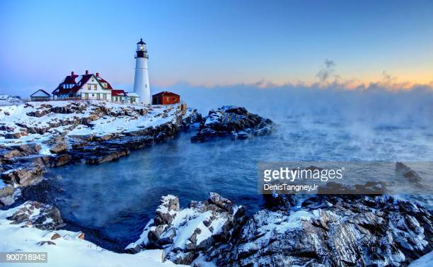 portland head lighthouse arctic sea smoke - new england usa stock pictures, royalty-free photos & images