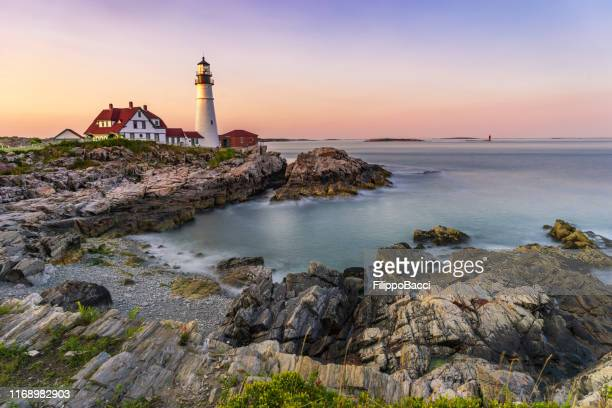 portland head lighthouse, maine, usa at sunset - portland maine stock pictures, royalty-free photos & images