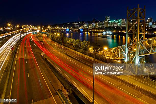 portland oregon downtown skyline at night - willamette river stock photos and pictures