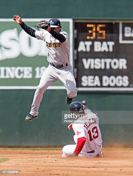 Portland Oscar Tejeda slides safely into second base as Trenton Jose Rosario sails overhead for the catch during second inning action at Portland Sea...