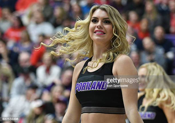 Portland Pilots cheerleader performs during a timeout during a West Coast Conference NCAA basketball game between the Portland Pilots and Gonzaga...
