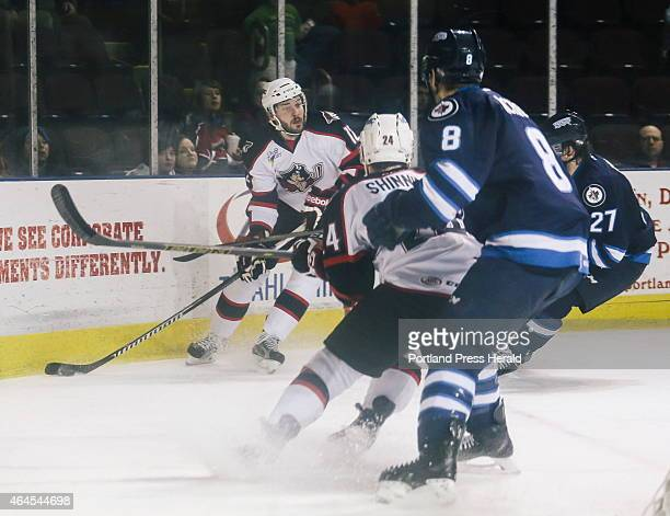 Portland Pirates player Justin Hodgman looks to pass while St John's player Brenden Kichton left and Will O'Neill try to get around Pirates' Brendan...