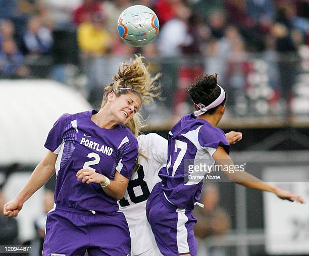 Portland players Lisa Sari and Lindsey Huie block Penn State's Allie Long from the ball during the 2005 NCAA Women's College Cup semifinal game...