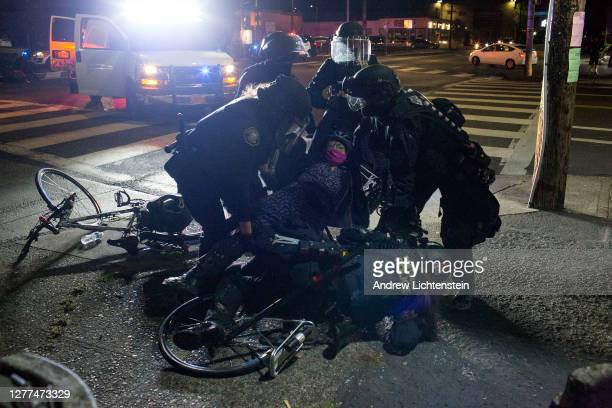 Portland police arrest a protestor near the police union building on September 28, 2020 in North Portland, Oregon. For over three months the Portland...