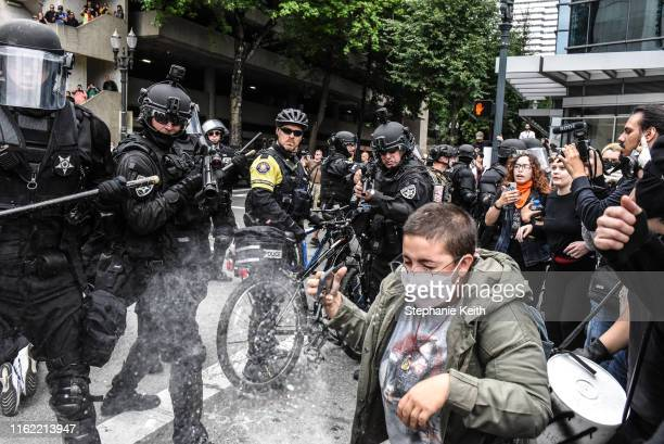 Portland police fire pepper spray rounds into a crowd of counter-protesters during an alt-right rally on August 17, 2019 in Portland, Oregon....