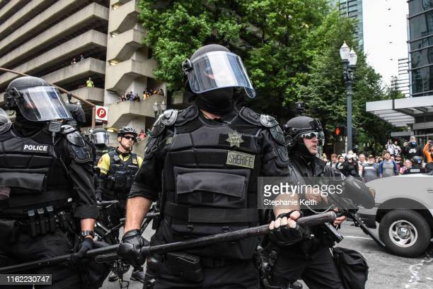 Portland police respond to protesters during an altright rally on August 17 2019 in Portland Oregon Antifascism demonstrators gathered to...