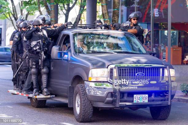 Portland Police riot gear detatchement patrols the area monitoring a small group of Antifa medical team after the riots at the Patriot Prayer Rally...