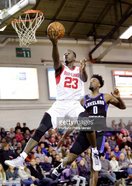 Portland Red Claws' Jabari Bird goes up for a shot as Lakeland Magic's Jamel Artis looks on during the second quarter of their game Sunday Dec 31...