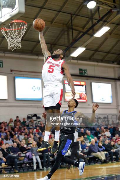 Portland Red Claws' Kadeem Allen goes up for a shot as Lakeland Magic's Jay Wright looks on during the second quarter of their game Sunday Dec 31...