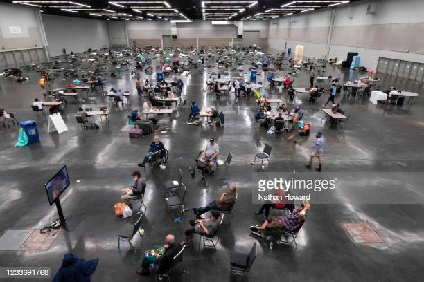 Portland residents fill a cooling center with a capacity of about 300 people at the Oregon Convention Center June 27, 2021 in Portland, Oregon....