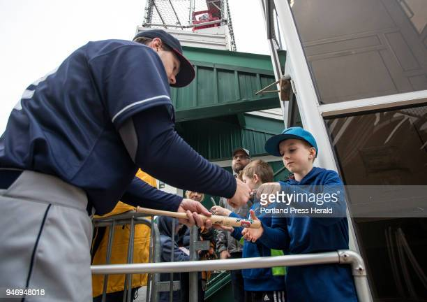 Portland Sea Dogs home opener at Hadlock Field on Friday April 13 2018 Finn McMahon of Portland gets an autograph from Kevin Taylor of Binghamton...