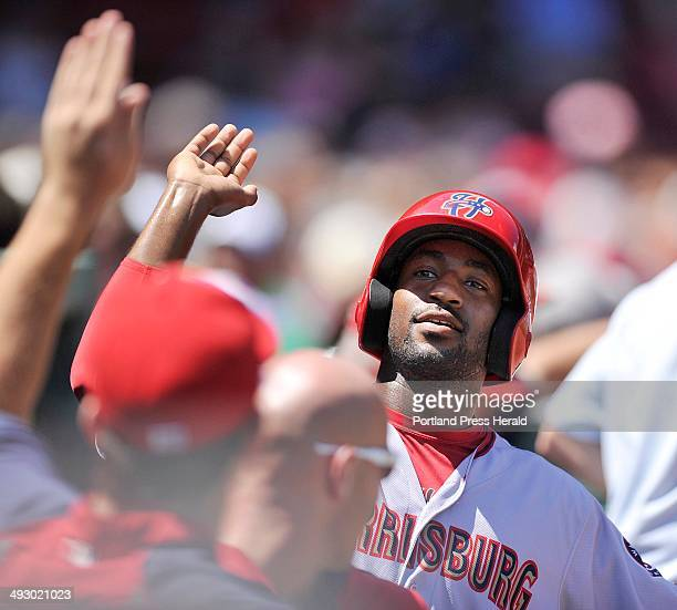 Portland Sea Dogs vs. Harrisburg Senators in the Futures Game played at Fenway Park in Boston. Senator centerfielder Brian Goodwin is greeted in the...