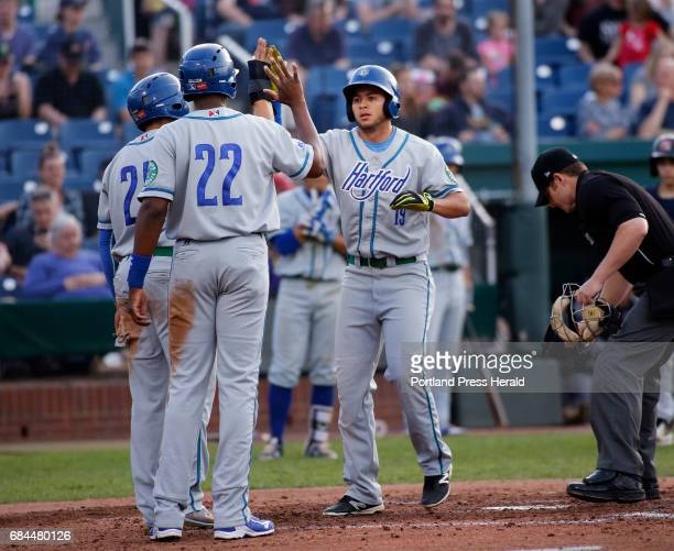 Portland Sea Dogs vs Hartford Yard Goats Omar Carrizales of Hartford right celebrates with teammates after hitting a grand slam off Portland pitcher...