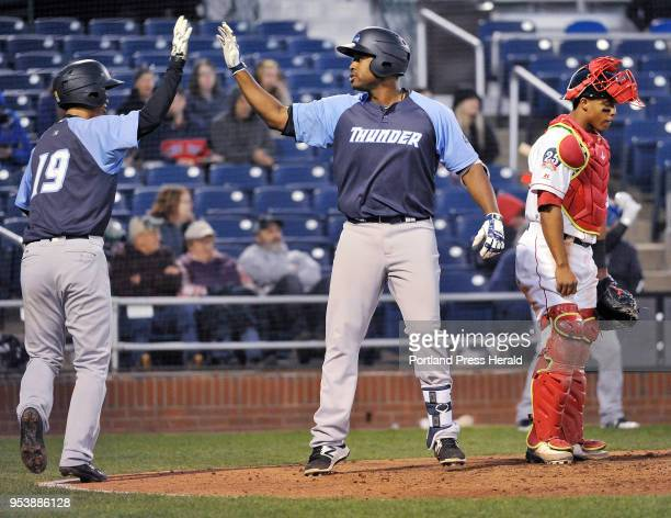 Portland Sea Dogs vs the Trenton Thunder baseball game Trenton's Chris Gittens is met at the plate by teammate Gosuke Katoh after hitting a two run...