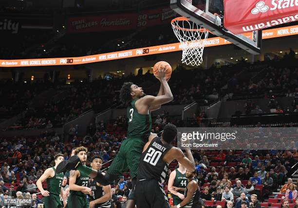 Portland State University guard Deontae North goes to the hoop over Butler University guard/forward Harry Baddley in a college basketball game during...
