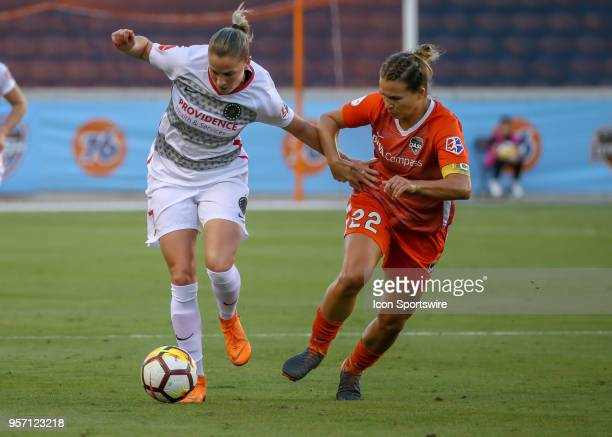 Portland Thorns FC Ana Maria Cmogorcevic and Houston Dash defender Amber Brooks fight for ball during the soccer match between the Portland Thorns...