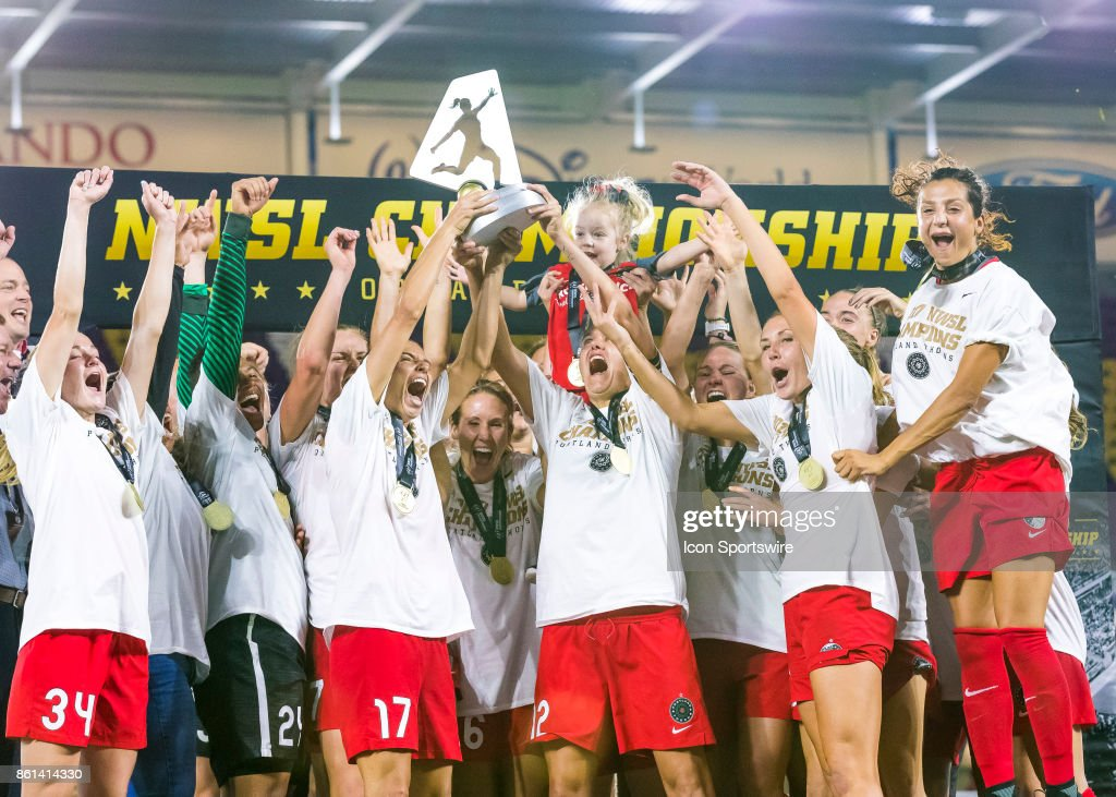 Portland Thorns FC celebrate the championship trophy during the NWSL soccer Championship match between the North Carolina Courage and Portland Thorns on October 14th, 2017 at Orlando City Stadium in Orlando, FL.