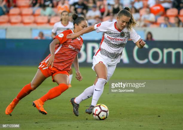 Portland Thorns FC midfielder Andressinha advances the ball down the pitch during the soccer match between the Portland Thorns and Houston Dash on...