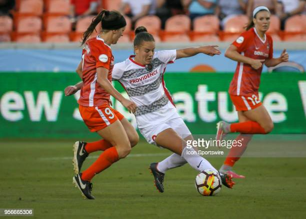 Portland Thorns FC midfielder Andressinha extends to take the ball from Houston Dash midfielder Haley Hanson during the soccer match between the...