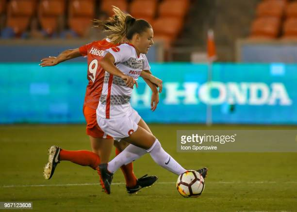 Portland Thorns FC midfielder Andressinha keep the ball away from Houston Dash midfielder Haley Hanson during the soccer match between the Portland...