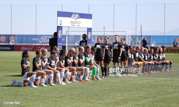 Portland Thorns FC Starting Eleven kneel in support of Black Lives Matter before a game between Portland Thorns FC and North Carolina Courage at...