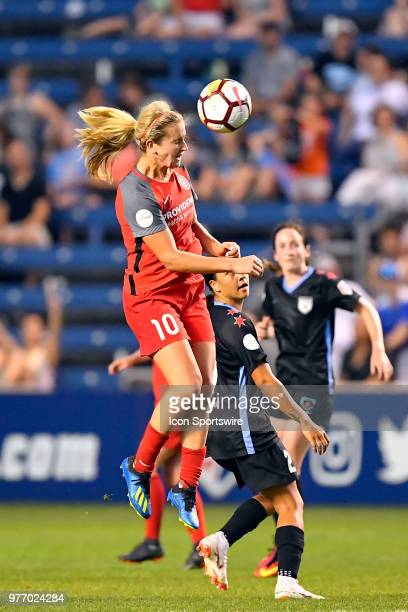 Portland Thorns FC's Lindsey Horan heads the ball against Chicago Red Stars's Sam Kerr on June 16 2018 at Toyota Park in Bridgeview Illinois